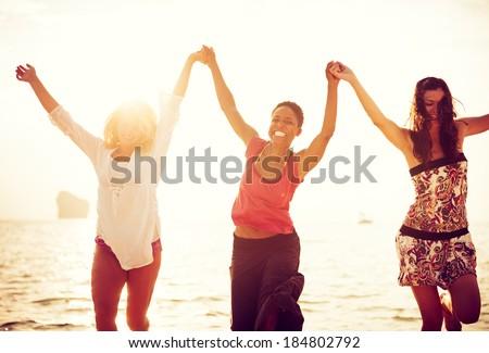 Women Dancing On Beach - stock photo