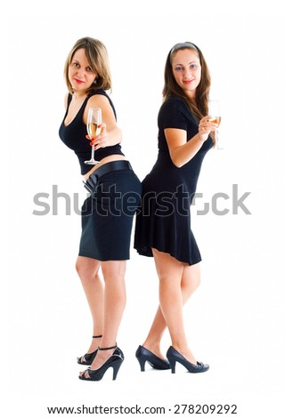 Women dancing with champagne glasses - stock photo