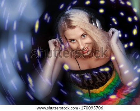 Women dj in headphones listening music isolated on a black background