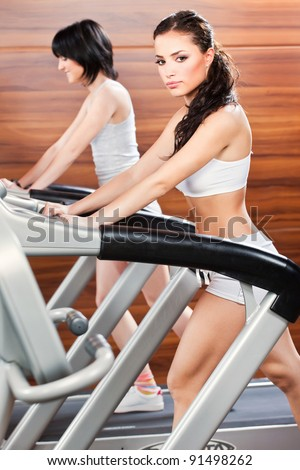 Women doing exercise in gym center - stock photo
