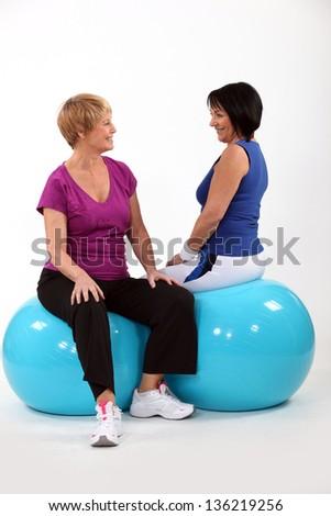 Women doing gymnastics - stock photo
