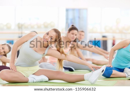 Women doing stretching in fitness club