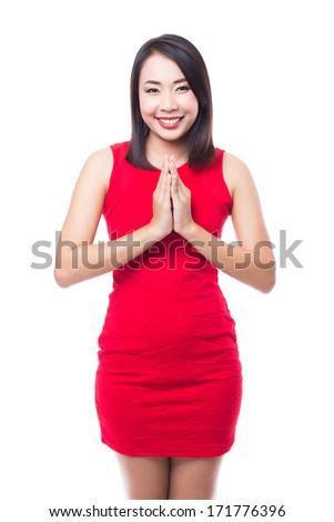 "Women doing Thai welcome, ""sawasdee"" - stock photo"