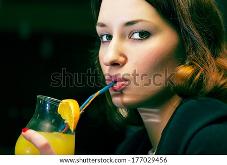 women drinking cocktail colorized image - stock photo