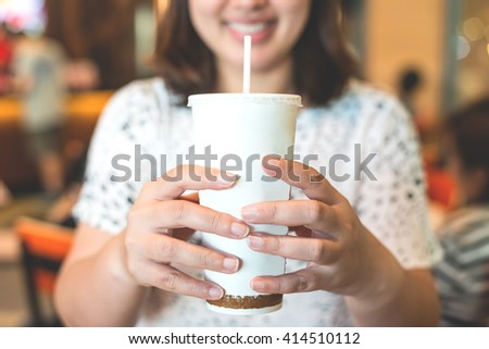 Women drinking cool water at food court - stock photo