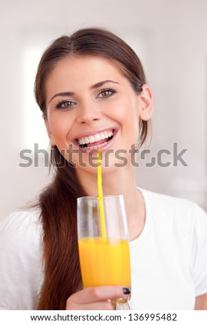 Women drinking orange juice - stock photo