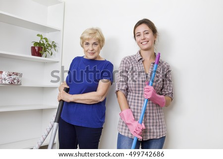 Women during cleaning floor.