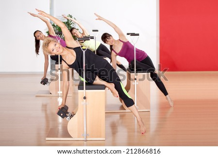 Women exercise in the gym - stock photo