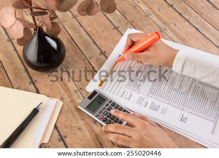 women filing taxes before deadline - stock photo