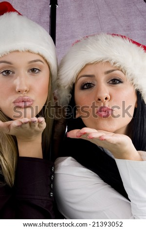 women giving christmas kiss with white background - stock photo