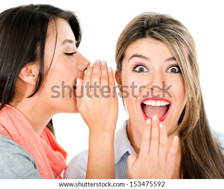 Women gossiping and telling a secret - isolated over white  - stock photo