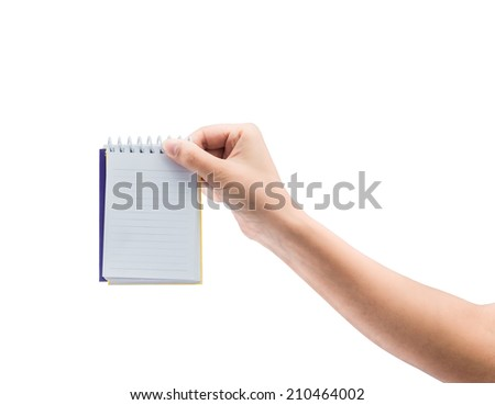 Women hand holding blank paper notebook isolated on white background - stock photo