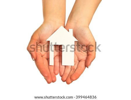Women hand holding paper house - stock photo