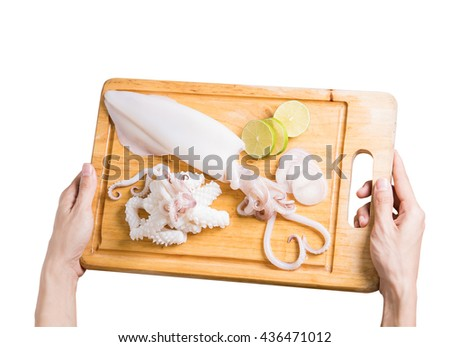 women hand holding wood board with Squid or cuttlefish and tentacles heart shape  on top,on isolated white background with clipping path - stock photo