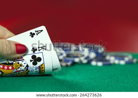 Women Hand Holds Ace with King and Poker Chips on the background  - stock photo