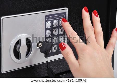 women hand opened electronic bank safe - stock photo