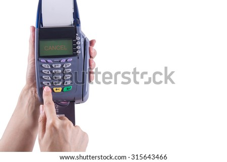 Women hand touch on Red Button in  Credit card machine with the word CENCEL , Isolated white background,Clipping path - stock photo