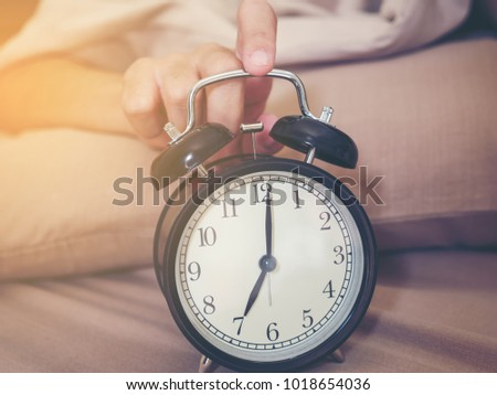 Women Hand Touch The Alarm Clock To Stop For Sound Of Ringing. Women Hand As