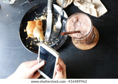 women hand use phone on breakfast time, croissants - stock photo