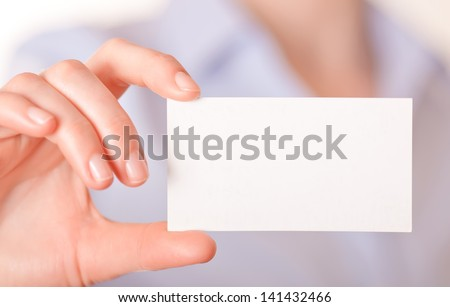 women handing a blank business card - stock photo