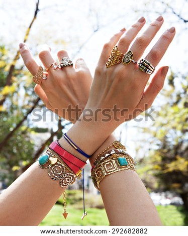 women hands full of jewels is a blurry background - stock photo