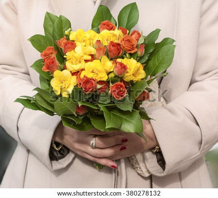 Women hands holding a  bouquet of natural  flowers. Celebration concept.