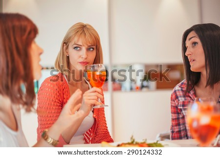 Women Having Fun And Drinking Aperol Spritz At Home - stock photo