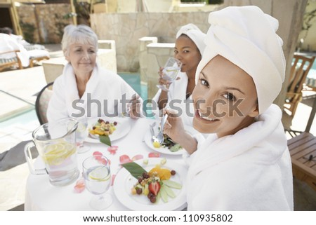 Women having healthy food with friends in the resort - stock photo