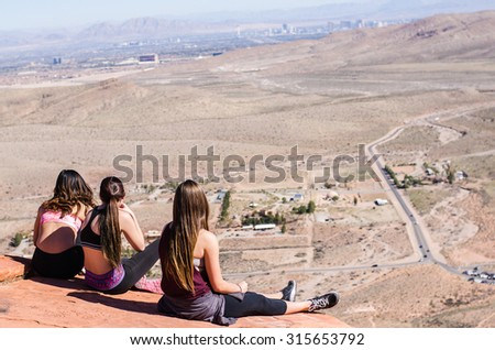 Women hiking on top of red rock canyon for looking Las vegas city, Nevada background - stock photo