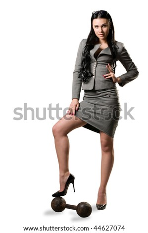 Women in a gray suit and an old dumbbell on a white background - stock photo