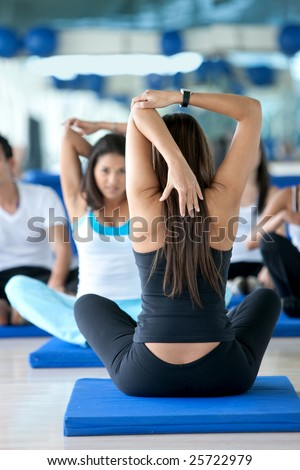 Women in a stretching class at the gym
