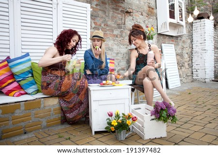 Women in outdoor cafe  - stock photo