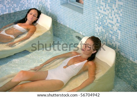 Women in swimsuit having a spa - stock photo