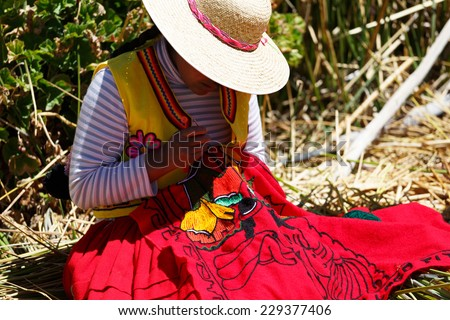Women in traditional clothes on Island Uros, Lago Titicaca, Puno, Peru - stock photo