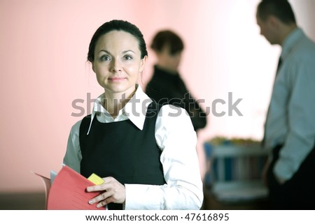 Women in white shirt with red folder - stock photo