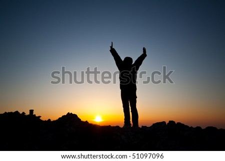 women is meeting sunrise on the top of mountain - stock photo