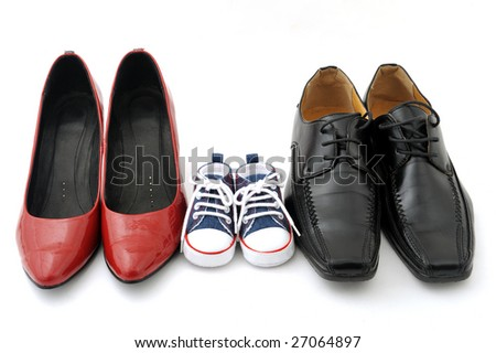 Women, kid, and men shoes on white background, family concept - stock photo
