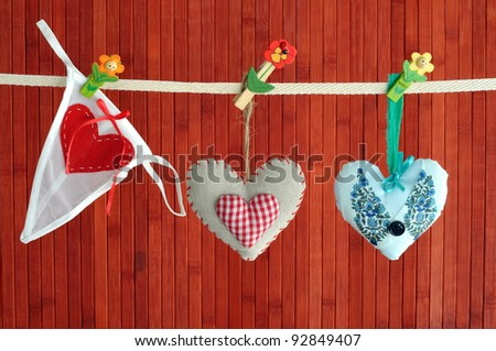 Women knickers and two homemade sewn hearts handing on a line - stock photo