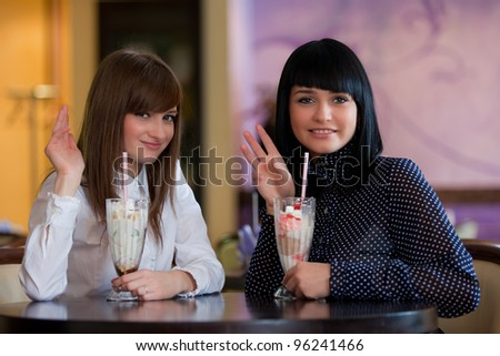women look in camera and waving hands - stock photo