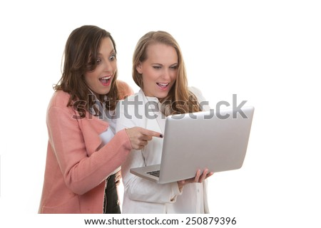 women looking at laptop searching on internet.  - stock photo