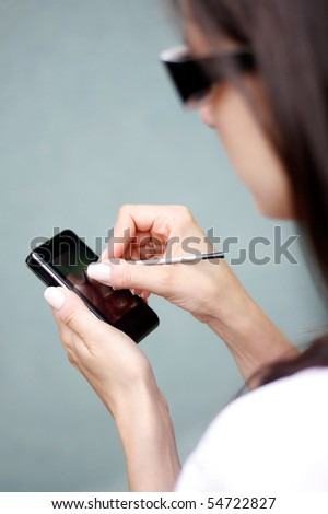 Women looking for data on their mobile - stock photo