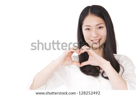 Women make a heart symbol by hand