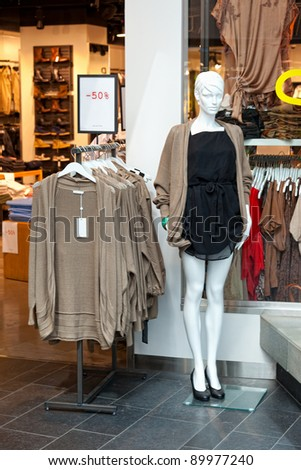 Women mannequin in shop of a fashion store. - stock photo