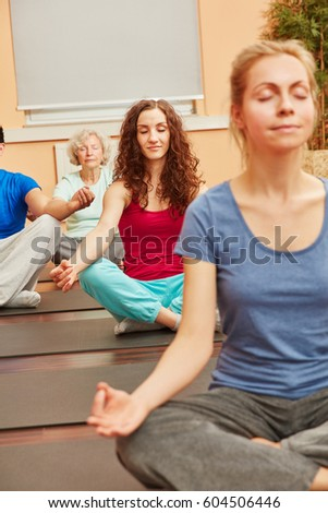 Women meditating in yoga class for relaxation