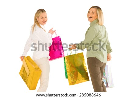 women mother and doughter carring shopping bags isolated on white background - stock photo