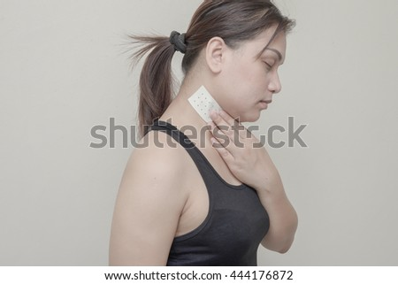 Women neck pain and sticking plaster.