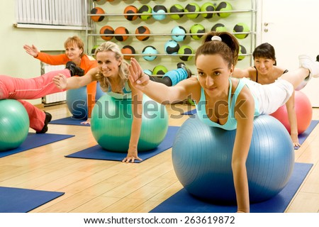 Women of Different Age (from 18 to 50) Doing Exercises with Balls - stock photo