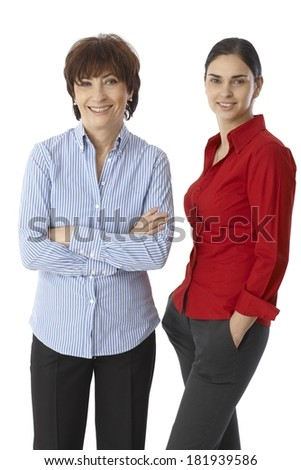 Women of two generations, mother and daughter smiling happy, looking at camera. - stock photo
