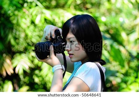 Women photographer at the park - stock photo