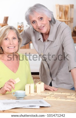 Women playing dominoes - stock photo
